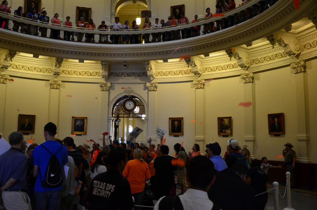 Forced birthers encircle pro-choice activists in an effort to invade and disrupt the pro-choice demonstration at the Texas Capitol rotunda, July 12, 2013 1:58 p.m., two hours after it began. Ultimately, pro-choice activists prevailed as the invaders were repelled. The rotunda protest began at noon on July 12, 2013 and continued into the early hours of July 13, 2013, after the final Senate vote on HB2 was taken. Image: Copyright 2013, Gary Oldham.